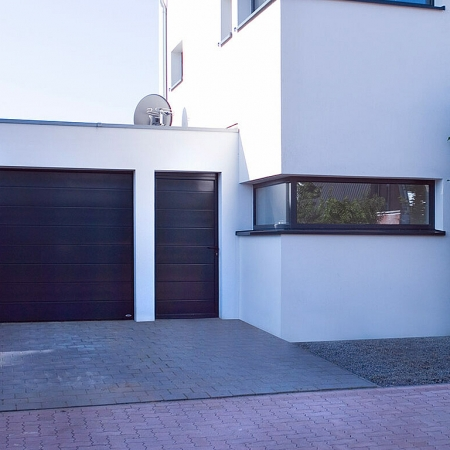 Matching side doors for sectional garage doors